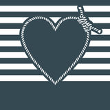 Heart shape made with rope on blue background Royalty Free Stock Photo