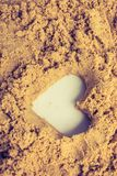 Heart shape made on the sand background. In view royalty free stock photography