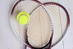 Heart shape made from tennis rackets. Close up on tennis racket and ball. Sport equipment background, wallpaper Royalty Free Stock Photo