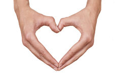 Heart shape made of two beautiful hands Stock Image