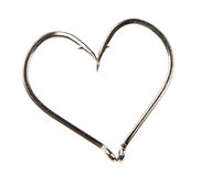 Heart Shape Made of Two Fish Hooks. A heart shape made of two fish hooks isolated on a white background Stock Images