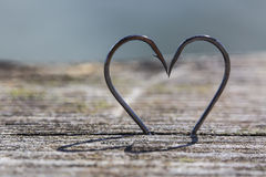 Heart Shape Made of Two Fish Hooks Royalty Free Stock Photo