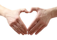 Heart shape made of two hands. Isolated over white background Royalty Free Stock Images