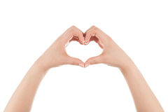 Heart shape made of two woman's hands. Two woman's hands are forming heart shape on white background Stock Photo