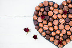 Heart Shape Made with Various Types of Chocolate Truffles Stock Photo