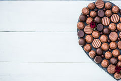 Heart Shape Made with Various Types of Chocolate Truffles Royalty Free Stock Photo