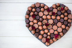 Heart Shape Made with Various Types of Chocolate Truffles Stock Images