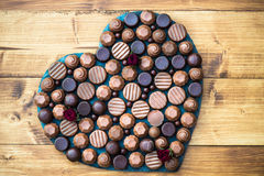 Heart Shape Made With Various Types Of Chocolate Truffles Royalty Free Stock Images