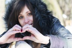 Heart shape made from woman hands Stock Image