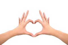 Heart shape made by woman's hand Stock Photography