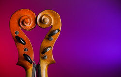 Heart shape make by violin scrolls Royalty Free Stock Image