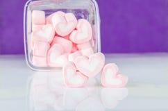 Heart shape mashmellow with purple background. Royalty Free Stock Image