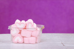 Heart shape mashmellow with purple background. Stock Image