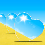 Heart shape mirrors in desert Royalty Free Stock Photo