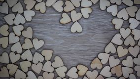 Heart shape from natural tree stop motion video. Heart shape from natural tree. Lovely heart shape by wooden small hearts on rustic wood table. Love theme stock video