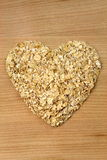 Heart shape oat flakes Stock Photos