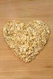 Heart shape oat flakes Stock Photos