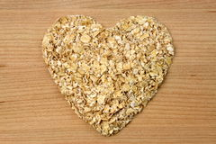 Heart shape oat flakes Royalty Free Stock Image