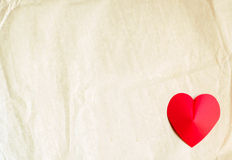 Heart shape on old paper background Stock Photography