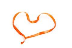 Heart shape of orange braid. On a white background Stock Photos