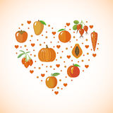 Heart shape with orange fruits and vegetables Stock Image