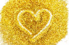Heart shape Outlined in Gold Glitter. Stock Image