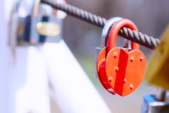 Heart shape padlock on bridge railing Stock Images