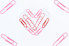 Heart shape by paper clips on white background Stock Photography