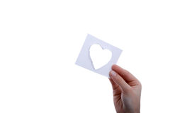 Heart shape paper in hand. Hand holding a heart shape paper cut out of paper on a white background Royalty Free Stock Photos