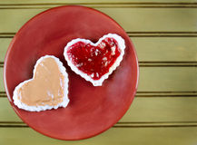 Heart shape peanut butter and jelly sandwtich Royalty Free Stock Photos