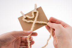Heart shape of pearls in hand Royalty Free Stock Images