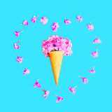 Heart shape of petals with ice cream cone with flowers over colorful Stock Image