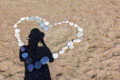 Heart shape and photographer`s shadow Stock Image