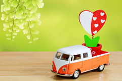 Heart shape on pick up and the wooden table,Valentine`s day Royalty Free Stock Image