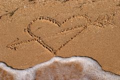 Heart shape picture on the beach Stock Photo