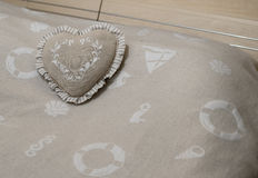 Heart shape pillow on the blanket Stock Photos