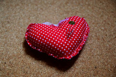 Heart shape. Pillow for brooches in heart shape Stock Photos