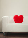 Heart shape pillow on sofa. Valentines day love. Red heart shape pillow on sofa couch. Valentines day love Stock Image