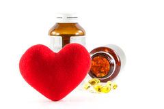 Heart shape and pills with bottles Royalty Free Stock Photo