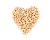 Heart shape from pine nuts. Stock Photo
