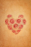 Heart shape pink rose on old brown grunge paper Stock Photography