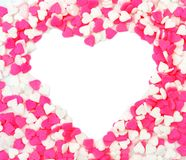 Heart shape within pink and white candy sprinkles Stock Images