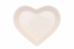 Heart shape plate. Isolated on white background stock images