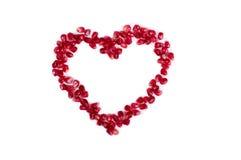 Heart shape from pomegranate Stock Photos