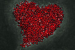 Heart shape from pomegranate seed's texture royalty free stock images