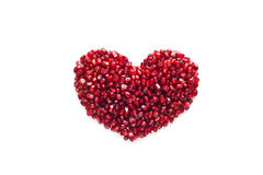 Heart shape from pomegranate seed on white background Stock Images