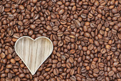 Heart shape in raw coffee beans. Stock Photography