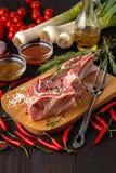 Heart shape Raw fresh meat Ribeye Steak with rosemary, pepper an stock image