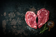 Heart shape raw fresh veal meat steaks stock photo