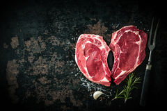 Heart shape raw fresh veal meat steaks stock image